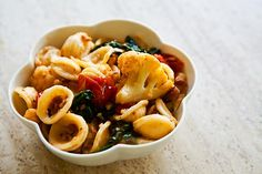 Pasta with Roasted Cauliflower and Prosciutto ~ Orecchiette pasta tossed with roasted cauliflower, roasted cherry tomatoes, prosciutto, arugula, and Parmesan. ~ SimplyRecipes.com