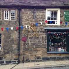 Le Tour de France yellow bike in Pateley Bridge next to the Oldest Sweet Shop.