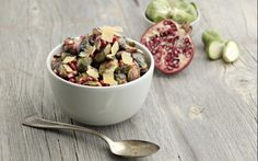 Bacon-Roasted Brussels Sprouts With Pine Nuts, Pomegranate and Aged Gouda