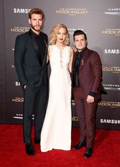 Liam Hemsworth, Jennifer Lawrence, and Josh Hutcherson attend the premiere of Lionsgate's 'The Hunger Games: Mockingjay - Part 2' at Microsoft Theater on November 16, 2015 in Los Angeles, California.