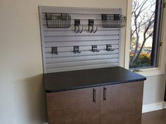Custom garage cabinets and workbench combination in the garage. Complete with Slatwall