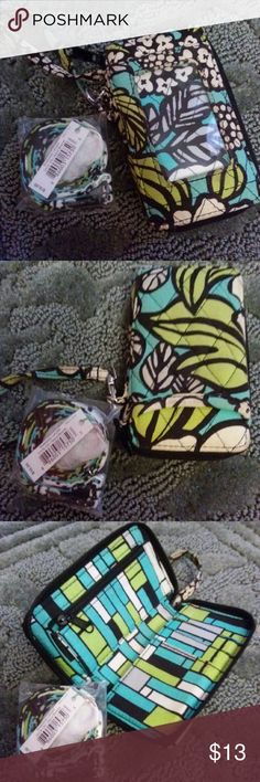 Vera Bradley Wallet with Lanyard Green and black Pattern is called baroque Comes with a lanyard that is retailed at $16 that is still in original packaging. Has ID pouch, multiple card spaces and an interior zipper pocket as well as an open outside pocket on the back. Send me an offer! Vera Bradley Bags Clutches & Wristlets