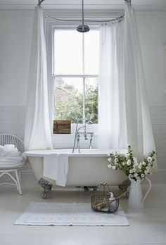 Curtained vintage tub - big window - yes!