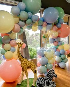 Jungle Baby Shower Balloon Decorations How to host the cutest Safari Baby Shower! Jungle baby shower ideas to inspire you! Baby Shower Balloon Decorations, Baby Shower Balloons, Birthday Balloons, Baby Birthday Decorations, Birthday Parties, Cute Baby Shower Ideas, Baby Shower Themes, Baby Boy Shower, Baby Showers