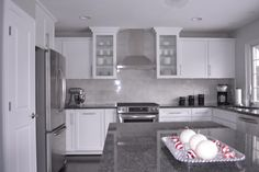 kitchens - Behr - Dolphin Fin - white Cabinets steel gray granite carrara marble stainless steel hood  Kitchen