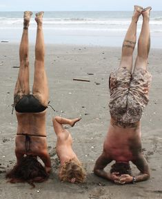 OMG - I want this for my little family :) yogatrail:  On the YogaTrail pose contest: Hali atPlaya Negra:Family yoga headstand!