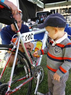 Helping dad with last minute pre-race bike fixes for visitors to the Hypercat Racing tent at the Carpinteria Triathlon - September 2014.