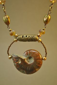 Ammonite Fossil and African Brass Necklace Set by Beechtree, $84.00