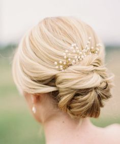 Featured Photographer: Jessica Gold Photography; Chic low updo wedding hairstyle idea.