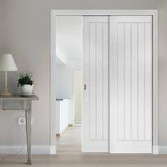 Deanta Twin Telescopic Pocket Ely White Primed Doors.    #telescopicdoors #twindoors #twintelescopicdoors #interiordoors #doubledoors #interiordesign #smartdoors #hiddendoors #inwalldoors
