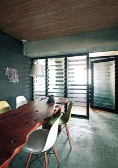 Louvered windows demarcate the space, allow diffused natural illumination into the room and lend vintage appeal besides provide shading and privacy