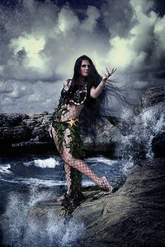 {In norse mythology, Ran is a sea goddess. She has a net in which she tried to capture men who ventured out to sea. She was often depict with long, black hair and dressed in a fish net}