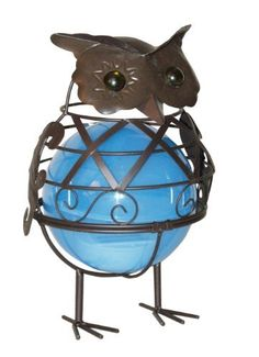 Woods International 17172BL Owl Metal Statue with Ball Light Inside, 10-1/4-Inch by 6-3/4-Inch by 6-1/4-Inch by Woods International. $15.99. Lights for 5 hours. Equiped with led timer light. Battery not included requires 2 aa batteries. Perfect accent for any garden setting. Lighted metal statue of an owl with a lighted blue ball. Metal lighted Owl statue with a blue ball plastic lining containing an LED light. The light is operated with a five hour timer. Sele...