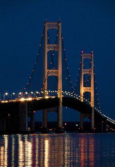 The Mackinaw Bridge at Night by the Straits of Mackinac between Lake Michigan and Lake Huron; photo by Randall Nyhof