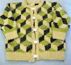 Child's cardigan with a cubic design by renowned knitting and textile designer Kaffe Fassett whose work is currently on display at the American Museum, Claverton near Bath.