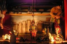 A Sicilian puppet show. This is no ordinary marionette or hand-puppet show. The Sicilian puppets are old, traditional, huge, and violent! They are hand-crafted in solid wood, wear metal armor, and brandish swords.