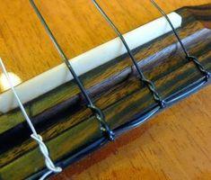 New Aquila 'Lava' Ukulele Strings Test Ukulele Strings, Cigar Box Guitar, Bridge, Circuits, Guitars, Ukulele Chords, Bridge Pattern, Bridges, Bro