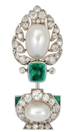 An Art Deco Natural Pearl, Emerald and Diamond Jabot Pin, circa 1920 Of jardinière design with a leafy potted shrub of palmette motif centered by a sugarloaf emerald between a pair of natural pearls measuring 11.61 mm by 8.25 mm, and 8.85 mm by 6.63 mm, and further embellished with old mine and old European-cut diamonds and calibré-cut emeralds, mounted in platinum.