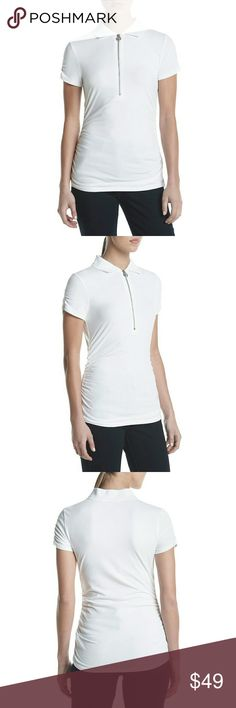 New! MICHAEL KORS MK Logo White Polo Shirt Top Go chic and casual with MICHAEL MichaelKors short sleeved polo, featuring MK logo zipper pull and chicruching.    Front zip closure with MK logo zipper pull  Short sleeves  Ruchingat sides and sleeves  Point collar  Fitted silhouette  Hits at hip  Cotton/Elastane  Machine washable  Retails for $59.50 Michael Kors Tops