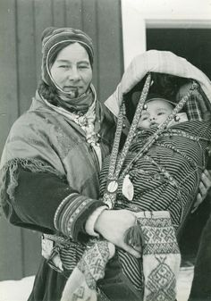 Sami Mother and child in traditional carrier. Finnmarksvidda, Norway. Photo by Elisabeth Meyer. (1899 - 1968)