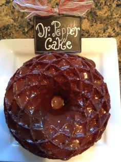 Dr.  Pepper Bundt Cake in Jubilee Bundt pan Recipe-1 German Chocolate Cake Mix, 1 small box instant vanilla pudding, 2/3 cup oil, 4 eggs, 1 t vanilla, 1 1/2 cups Dr. Pepper.   Heat oven-325 degrees.  Mix cake & pudding mixes with oil. Add 1 egg at a time until blended. Add vanilla & Dr. Pepper.  Pour into a greased and floured bundt pan & bake 45-50 min.  Cool cake-15 min, then invert on rack.  Icing: 1 c. Powdered sugar, 5 T cocoa, 1 t vanilla, 1 1/2-2 T Dr. Pepper.  Mix & drizzle over…