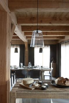 Chalet style - love the glass softening the wood. i would need a bit more color in this place for a softer more cozy feel