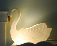 Make a Swan Lamp  .... {i just might hafta do this. possibly use an empty bleach bottle to create a back just for water proof purposes ... but i can SO see this sitting in my rock/planter garden just outside my back door ... OR MAYBE parked outside my front door under the awning/overhang !!!}
