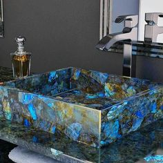 Beautiful!!! This Sink And The Counter Are Made Of Labradorite. It Is