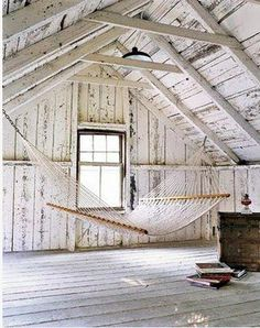 Hammock in the attic. Completely romantic. Imagine up here with a mug of tea on a rainy day, reading a great book and listening to the rain fall on the roof above?