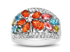 From our 'Rainbow Topaz' Collection: A lush garden of natural topaz lights up this statement-making ring. White, honey yellow, rainforest green, poppy orange, pink, and ice blue topaz.