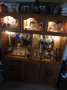 Re-purposed an entertainment center into the back of a bar. Added doors, lights and etched glass doors and voila! I wouldn't etch the doors... Not sure about displaying the booze....