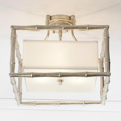 """Silver Bamboo Square Ceiling Light This Antique Silver frame Bamboo square ceiling light combines a sleek white linen inner shade. A combination of timeless design elements with the popularity of the """"faux"""" bamboo design give this light high style and sophistication. (13""""Hx16""""W)"""
