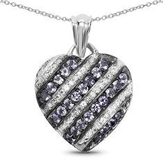 Genuine Round Tanzanite and Tanzanite Pendant in Sterling Silver. Sterling Silver. Genuine Tanzanite, Tanzanite, and Cubic Zirconia. Chain Not Included.