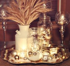 A Holiday Centerpiece Idea:  This would be a simple one to re-create, yet make it your own!  Just mason jars, mercury glass, kosher salt, candles, ornaments, milk can with wheat, all on a pretty tray!  {gold tray was bought at Target.}  Try adding different colors, textures, etc.