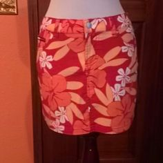 Beautiful Skirt Tommy Jeans Beautiful Skirt Tommy Jeans color red floral Waist 28 inch /Long 13 inches. 97% Cotton /3%Spandex Tommy Jeans  Skirts