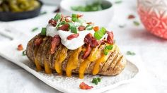 Hasselback potatoes are perfect for the big game, or as a side to your favorite dinner. Our version is loaded with cheese and all your favorite toppings.