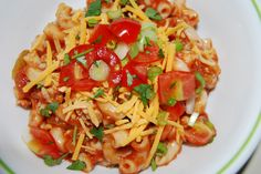 Mexican Macaroni 1 lb browned meat with 1/2 c onion and 2 minced garlic cloves. Add 12oz salsa, 4 oz green chilies, 14 oz tomato sauce, 1/2 c water,  4 to 5 cups cooked macaroni, top with sour cream, cilantro, tomatoes, green onion