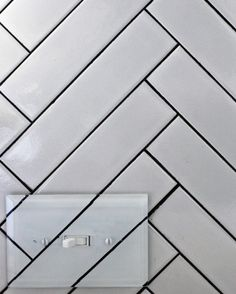 Vintage The rest of the backsplash is white tiling that was cleverly placed into a herringbone pattern