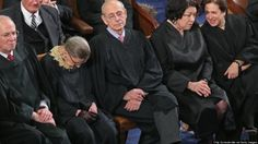 Justice Ginsberg looks like she is hanging her head in shame after the ruling....I'm with her.  This is a sad day for America