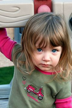 Cute toddler look! Her longer layers gently frame her entire face along the sides.