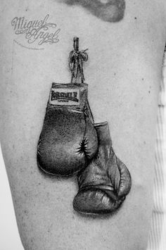 Flickr Lonsdale© boxing gloves tattoo by Miguel Angel on Flickr. Just follow this link to see and comment on this photo: https://flic.kr/p/pbmB4c