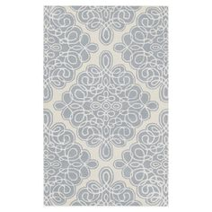 New Zealand wool rug with a scrolling diamond motif. Hand-tufted in India.  Product: RugConstruction Material: 1...