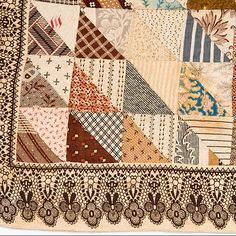 1880's child's quilt with lace print border  gift of Pat L. Nickols-Mingei Museum