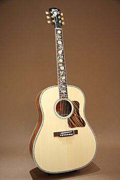 Gibson J-45 Vine Koa Custom 2013. Figured Koa back  sides, abalone rosette and binding.