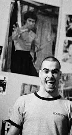 Henry Rollins with bruce lee looking over his shoulder. 1982
