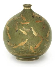 """A small Satsuma globular vase by Kinkozan, Meiji period. Finely decorated in enamels and gilt with an all-over design of a shoal of carp swimming among acquatic plants above key free reserved on a moss- green ground, the base with impressed seal Kinkozan Zo. 41/2"""""""