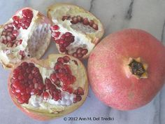 Pomegranate: they just arrived at the Farmers' Market today ~ they are perfect ~ grab them before the rain (which causes them to split and mold.) Edible Rubies! These are from Ed's Peach Farm, brought to us by Nick! Photo © 2012 Ann M. Del Tredici