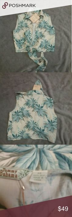 NWT Tommy Bahama Silk wrap shirt size XS New with tags 100% Silk wrap shirt size XS color is chalk , green and white Tommy Bahama Tops