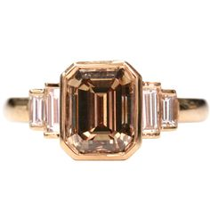 Brown Emerald Cut Diamond Engagement Ring   From a unique collection of vintage engagement rings at https://www.1stdibs.com/jewelry/rings/engagement-rings/