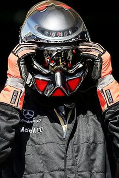 McLaren pit stops reflects in the visor of a mechanic.  Formula One World Championship, Rd 1, Bahrain Grand Prix, Preparations, Bahrain International Circuit, Bahrain, 9 March 2006
